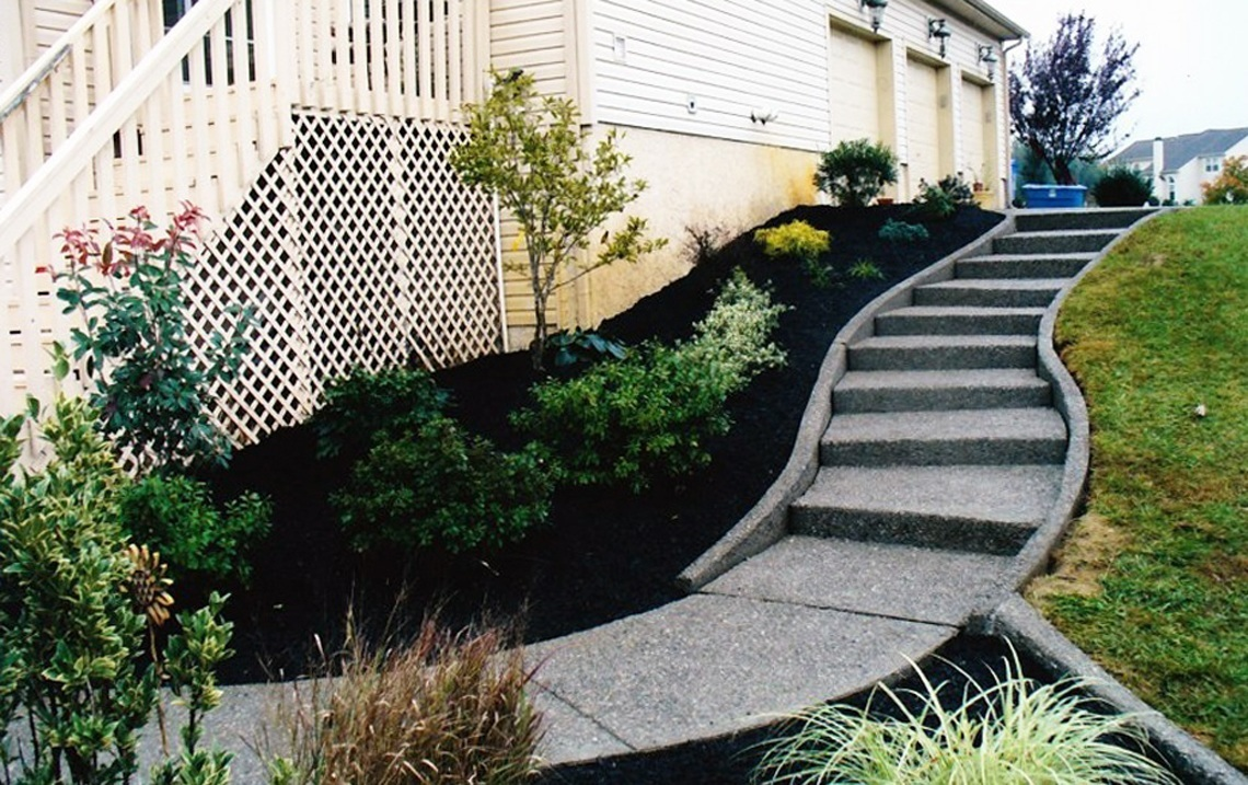 concrete steps integrated into landscaping